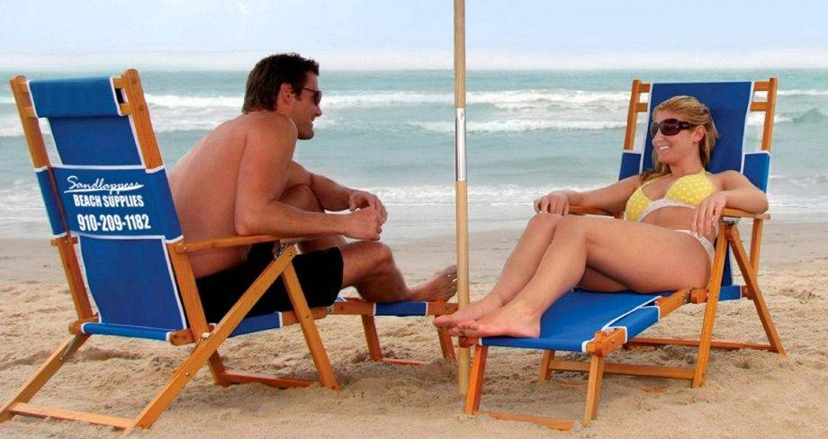 couple enjoying the beach on rental chairs